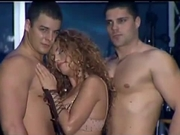Serbian singer with wo male stripers