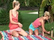 Two logging blond babes are fucking on picnic