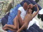 This couple were shot on the camera getting naughty on the beach