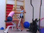 Two pretty blonde lesbians fucking each other in the gym