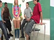 A nasty blonde sucks many dicks in the classroom and gets a bukkake