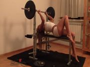 Horny blond Anna gets naked and rubs her pussy in the gym