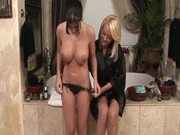 Two cute lesbian babes wash each other and lick pussies