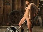 Sexy Country Babe Plays in a Barn With Her Machines