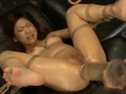 Fucking a Bondaged Asian with Dildo and Other Sex Devices