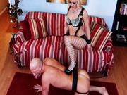Dark mistress Ash Hollywood dominates over her bald slave