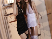 Japanese goddesses Nao and Yuria posing in sexy black stockings