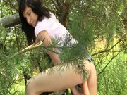 Daring teen Barbara masturbates outdoors and playing with a carrot in her cunt
