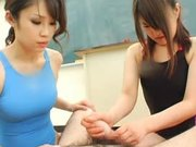 Sexy Japanese Teacher Showing a Cute School Girl How To Give a Handjob