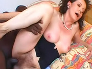Interracial video with hairy mature white chick