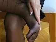 Foot tease in sexy black stockings