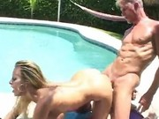 Busty milf fucked by the pool