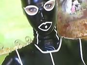Hot babe in a rubber latex suit