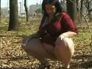 Fat or pregnant woman peeing in public
