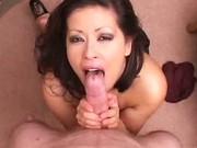 Asian MILF Sucking On Cock