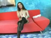 Sexy nylon babe spreading legs and squizing her tits