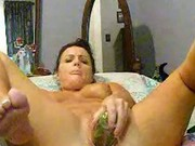 Horny housewife masterbates with cucumber