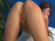 Brunette teen gets her oiled body pumped on massage table