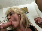 Lewd blonde MILF enjoying two dicks