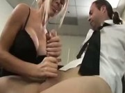 Blonde gives handjob in office