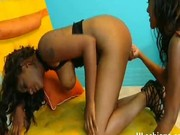 Hot lez ebonies use toys to fuck each others pussies
