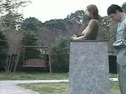 Green Japanese garden statue has tits felt up