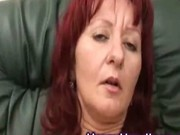 Mature redhead with big tits masturbates on the couch