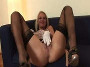 British lesbians in stockings put dildo up their pussies