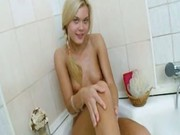 Pigtailed blonde bathroom diva posing