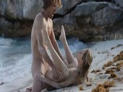 Teen couple having sex on the beach