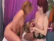 Mature lesbians dildoing their pussies
