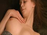 Busty Beata girl teasing on the sofa