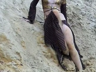 Small tits strip on the sand