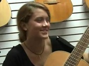 Brunette Flashing Her Tits In A Music Store