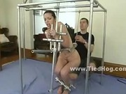Big chains and bondage toys hold poor slut immobilized under the
