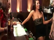 Clothed babes pull his cock on the bar