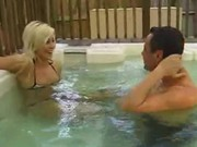 Blonde girl sucks cock in a jacuzzi