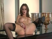 Big-boobed brunette pornstar Emily Addison cums on her toy