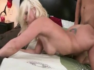 Busty blonde cougar oral sex and pounded hard on the couch