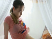 Petite masturbation behind curtains