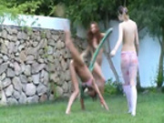 Russian teens watersports in the garden