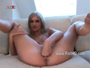 Gorgeous blonde self fisting her shaved snatch