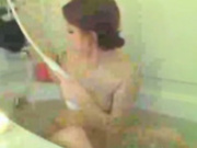 Brunette Masturbates With The Showerhead In The Bathtub