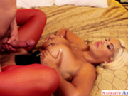 Bridgette B takes a load on her big giant tits