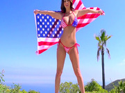 Ava Addams wearing bikini poses with the Flag of America