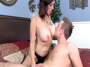 Tara Holiday offers her big fake tits to her stepson