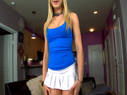 Amy Brooke in a sexy mini-skirt posing and teasing
