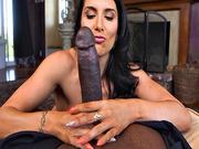 Romi Rain strokes a big black cock bigger than her forearm