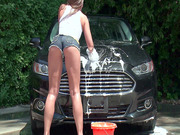 Amirah Adara in heels, tight shorts and a-shirt washing her ex's car