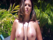 Danica Dillon posing poolside in a skimpy bikini